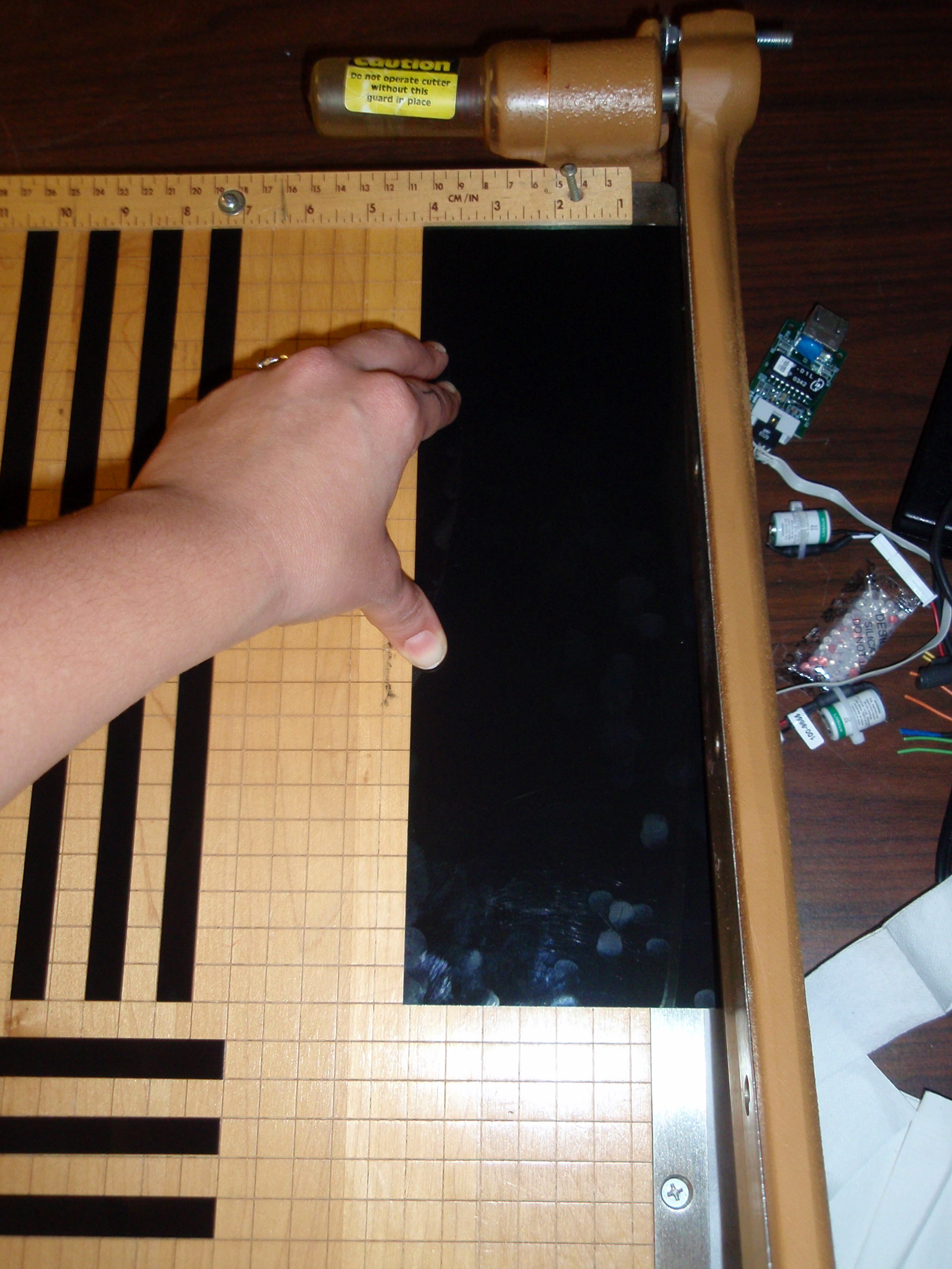 "Cutting the liquid crystal sheets into 1/2"" strips."
